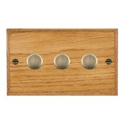 Hamilton Woods Chamfered Medium Oak 3 Gang 2 way 400W Dimmer with Antique Brass Insert