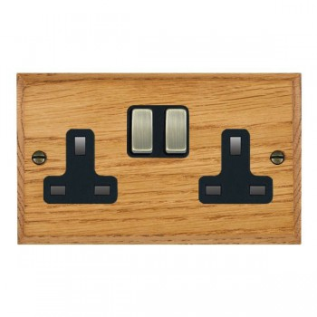 Hamilton Woods Chamfered Medium Oak 2 Gang 13A Switched Socket with Black Insert