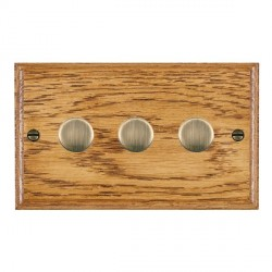 Hamilton Woods Ovolo Medium Oak 3 Gang 2 way 400W Dimmer with Antique Brass Insert