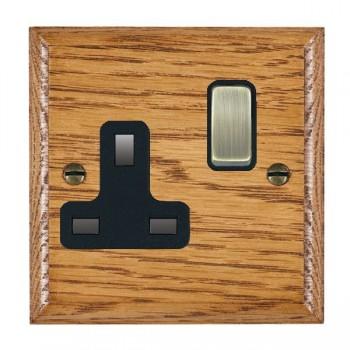Hamilton Woods Ovolo Medium Oak 1 Gang 13A Switched Socket with Black Insert