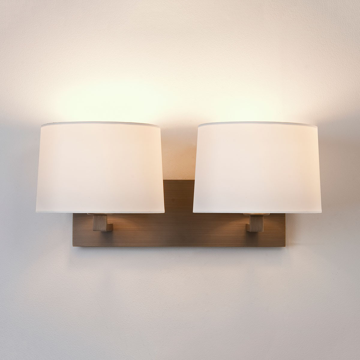 Astro Azumi Twin Bronze Wall Light at UK Electrical Supplies.